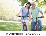 mature couple bike riding. | Shutterstock . vector #14237773