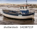 old wooden fishing boat on mud...   Shutterstock . vector #142387219