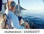 Sailing Man Reading Tablet...
