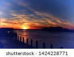 sunset by the dock at... | Shutterstock . vector #1424228771