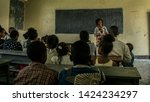 attending lecture at primary... | Shutterstock . vector #1424234297