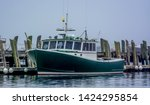 maine lobster boat tied up at a ... | Shutterstock . vector #1424295854