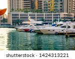 white yachts on green water... | Shutterstock . vector #1424313221