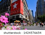 Small photo of Manhattan, New York, USA - June 4, 2019: Macy's Herald Square Flagship Department Store in Midtown Manhattan with people crossing the street in front of it