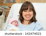 happy mother with her newborn... | Shutterstock . vector #142474021