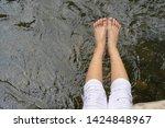 children feet playing in the...   Shutterstock . vector #1424848967