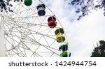 ferris wheel in the park...   Shutterstock . vector #1424944754