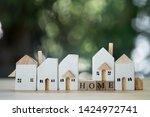 miniature wooden home. concept...   Shutterstock . vector #1424972741