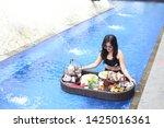 poolside breakfast asian women...   Shutterstock . vector #1425016361