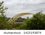 Daniel Carter Beard Bridge, yellow twin span steel bowstring arch bridge crossing the Ohio River in Cincinnati, Ohio.