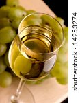 a glass and grape with white wine - stock photo