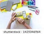 school bus made of cardboard.... | Shutterstock . vector #1425346964