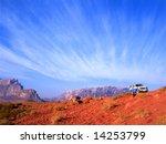 Exploring with a four wheel drive the Wadi rum desert in Jordan - stock photo