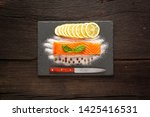 piece of salted salmon on a... | Shutterstock . vector #1425416531