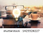 bulb drawing with glasses on... | Shutterstock . vector #1425528227