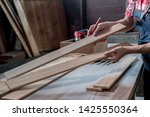 carpenter working with... | Shutterstock . vector #1425550364
