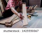 carpenter working with... | Shutterstock . vector #1425550367