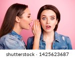 Small photo of Close up photo two sisters beautiful amazing funky she her ladies perfect appearance tell say rumours ear unexpected unbelievable news wear jeans denim jackets blazers isolated bright pink background