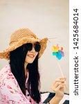 woman enjoying beach relaxing... | Shutterstock . vector #1425684014