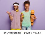 sporty guy lifts heavy dumbbell ... | Shutterstock . vector #1425774164