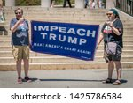 Small photo of Boston, MA / USA - June 15, 2019: Crowd of citizens protest to impeach President Donald Trump at rally held in front of the state capital building in Boston.