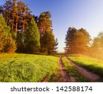 rural sandy road at sunrise | Shutterstock . vector #142588174