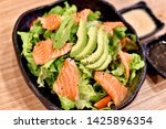 salmon and avocado salad with... | Shutterstock . vector #1425896354