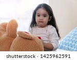 cheerful cute little girl with... | Shutterstock . vector #1425962591