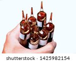 Small photo of Hand holding drinkable ampoules for iron and copper deficiency anaemia. Iron supplement in liquid form. The formulation includes Copper and Manganese. Isolated image with white background.