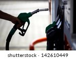 detail of a hand holding a fuel ...   Shutterstock . vector #142610449