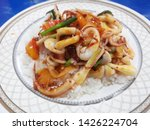 spicy squid with rice... | Shutterstock . vector #1426224704