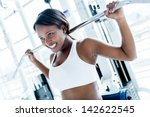 woman at the gym working out on ... | Shutterstock . vector #142622545