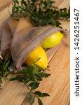 lemons on old wooden desk | Shutterstock . vector #1426251467