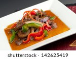 A beautifully presented dish of Thai food with mixed vegetables beef and brown rice. - stock photo