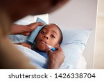 father caring for sick son ill... | Shutterstock . vector #1426338704