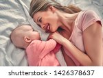 young beautiful mother with her ... | Shutterstock . vector #1426378637