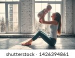 young beautiful mother with her ... | Shutterstock . vector #1426394861
