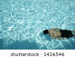 a man swimming and diving under ... | Shutterstock . vector #1426546