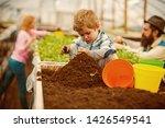 soil preparing. small boy... | Shutterstock . vector #1426549541