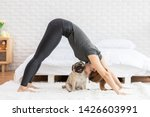 Woman Practice Yoga Downward...