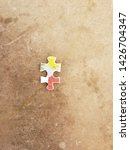 Small photo of isolated puzzle piece on a table