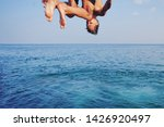 Young Man Jumping Off Cliff...