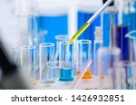A Pipette Dropping Sample Into...