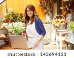 smiling mature woman florist... | Shutterstock . vector #142694131