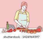 a woman is wearing an apron and ... | Shutterstock .eps vector #1426964597