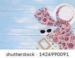 beach accessories on blue plank ... | Shutterstock . vector #1426990091