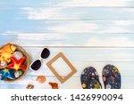 beach accessories on blue plank ... | Shutterstock . vector #1426990094
