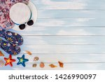 beach accessories on blue plank ... | Shutterstock . vector #1426990097