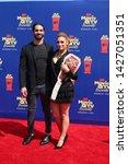 Small photo of LOS ANGELES - JUN 15: Seth Rollins, Becky Lynch at the 2019 MTV Movie & TV Awards at the Barker Hanger on June 15, 2019 in Santa Monica, CA