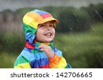 Little Boy Enjoying The Rain...